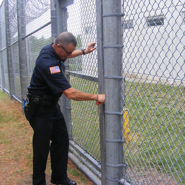 prison perimeter check by officer